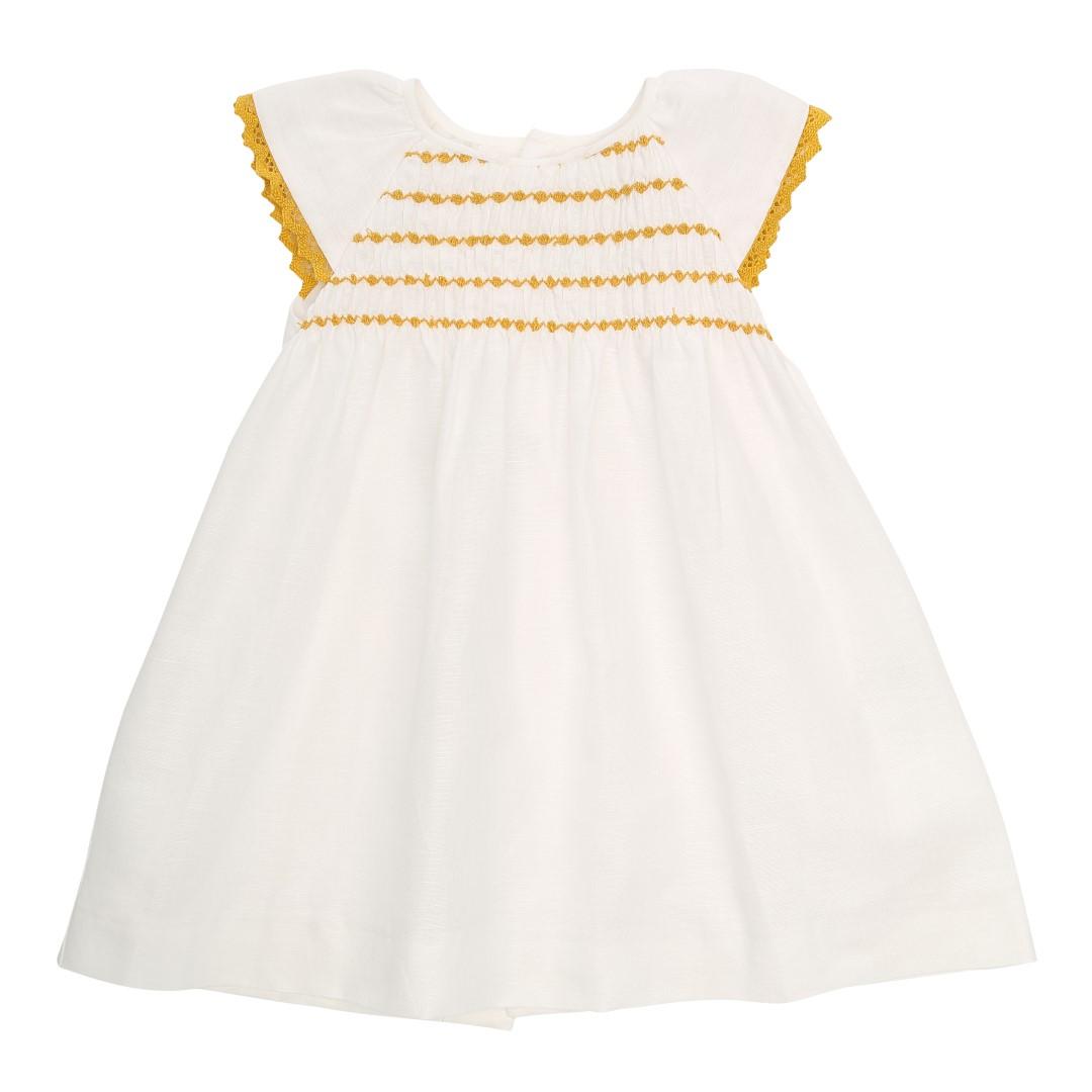 Vera kjole i hvidt bomuld og hørstof med håndlavet smock